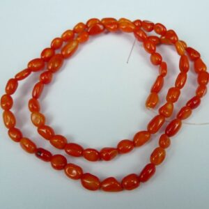 Små pebbles i bambuskoral, orange