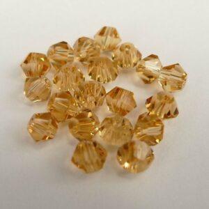 20stk Honey gold bicone glasperler 4mm.