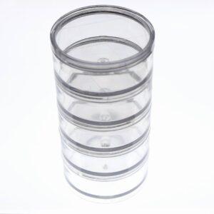 Søjle med runde plastæsker i klar plast
